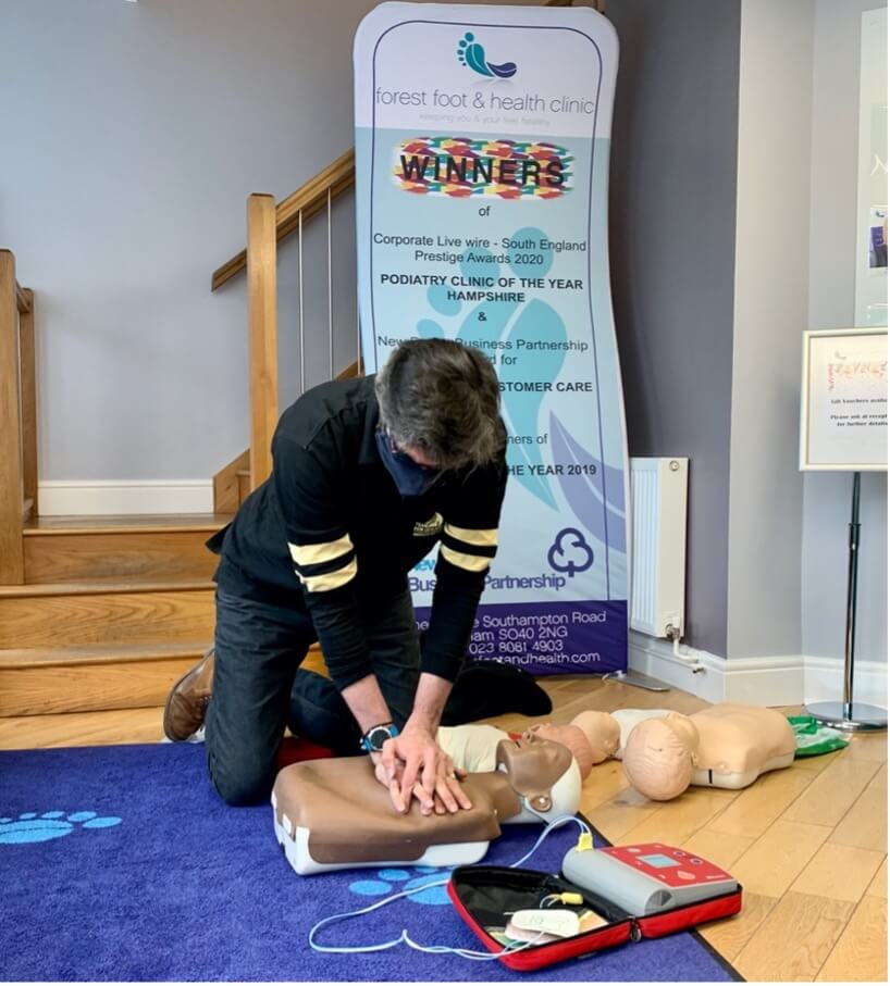 Forest foot and health clinic undergoing CPR training