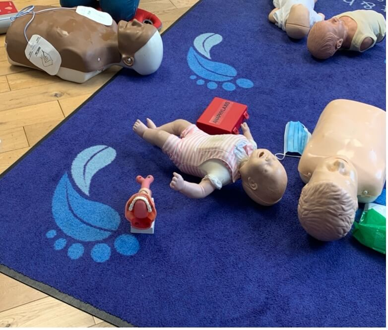 Staff at forest foot and health clinic undergoing CPR training